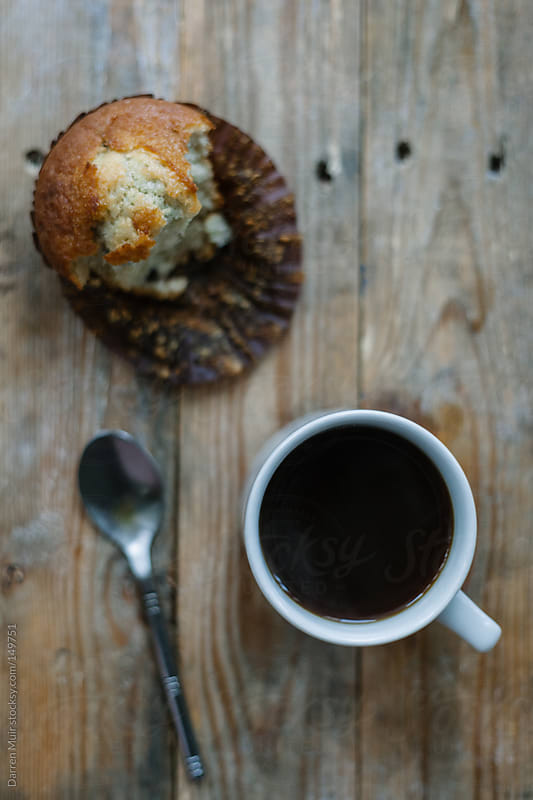 Coffee and a muffin. by Darren Muir for Stocksy United