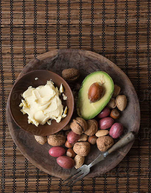 Grouping of Foods with Healthy Fats - Nuts, Butter, Avocado by Jeff Wasserman for Stocksy United