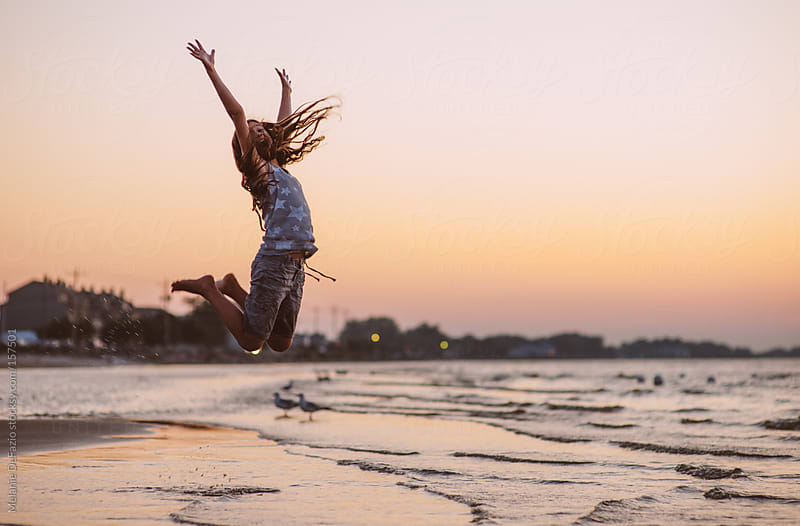 Jumping by Melanie DeFazio for Stocksy United