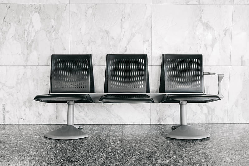 Waiting Bench At Airport by Nemanja Glumac for Stocksy United