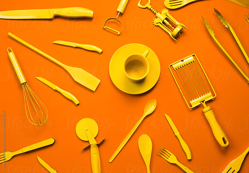 Kitchen objects on orange backgorund by Audrey Shtecinjo for Stocksy United