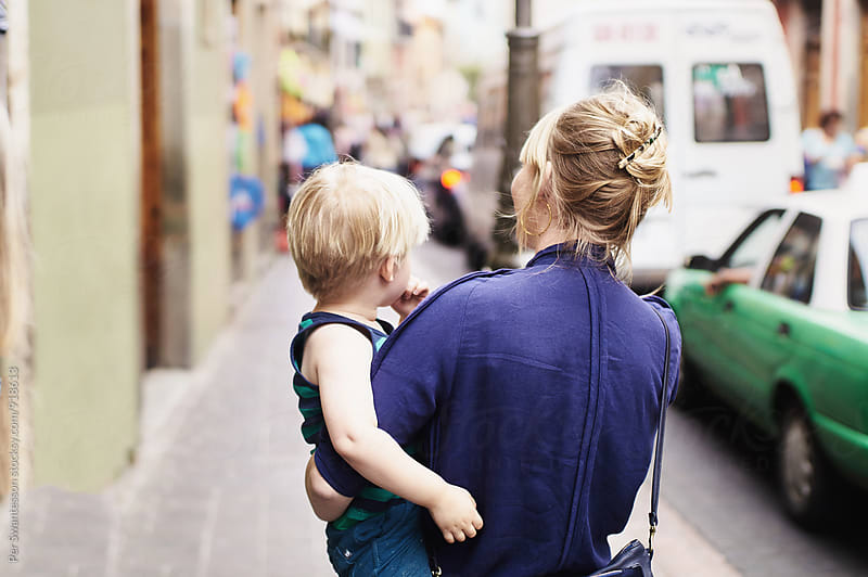 Mom and her 3 year old son walking in a city by Per Swantesson for Stocksy United