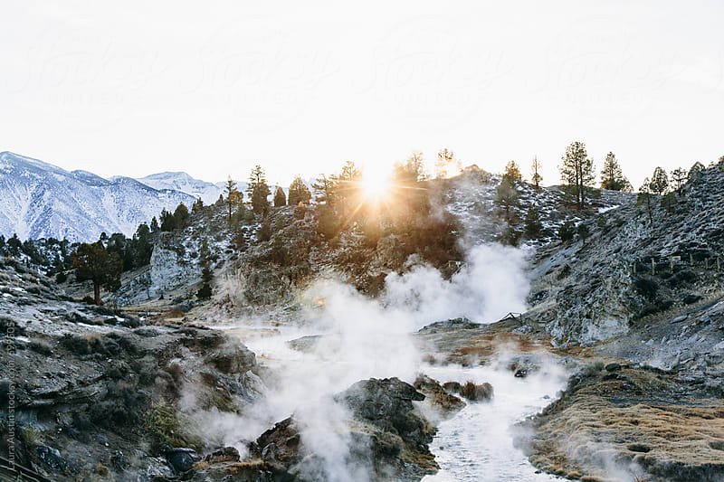 Mist Rising Off A River in a beautiful Mountain Landscape by Laura Austin for Stocksy United
