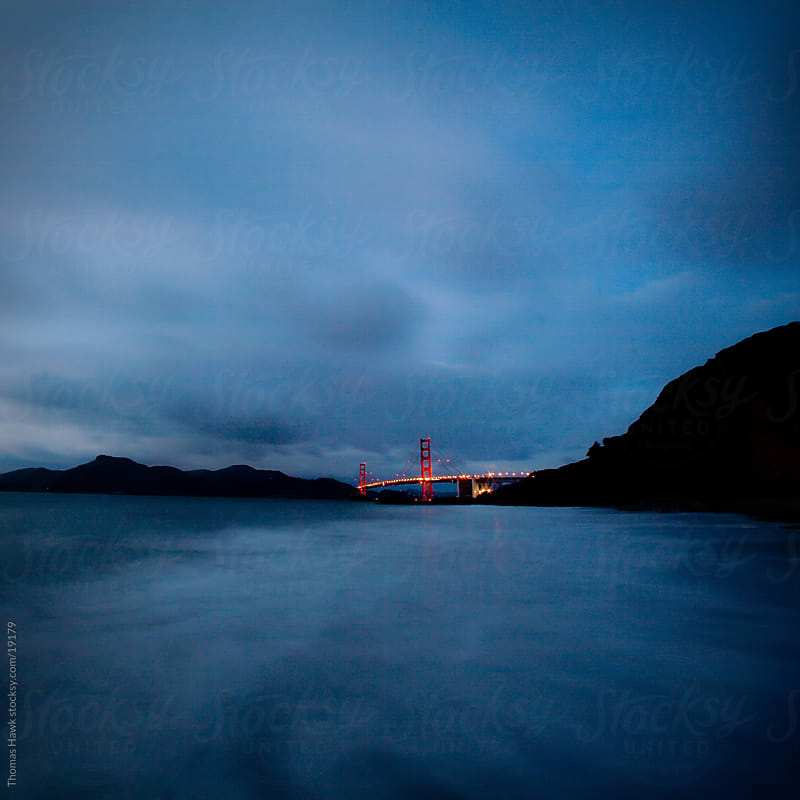 Golden Gate Bridge in the Distance with clouds by Thomas Hawk for Stocksy United