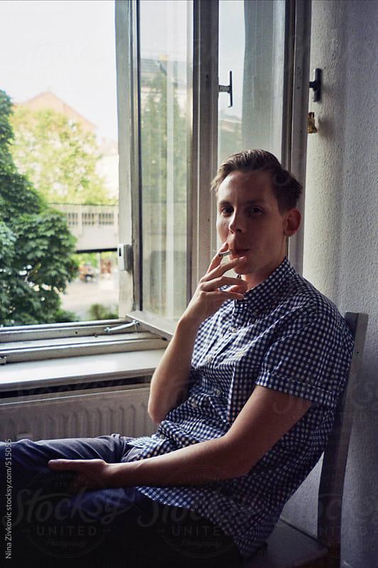 Young man smoking. by Nina Zivkovic for Stocksy United