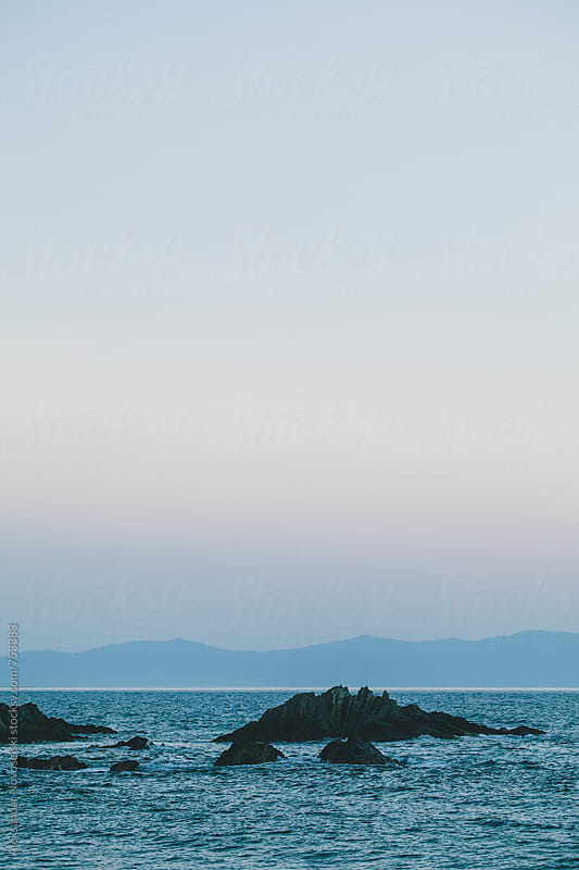 Minimalist seascape by dusk with rocks by Aleksandar Novoselski for Stocksy United