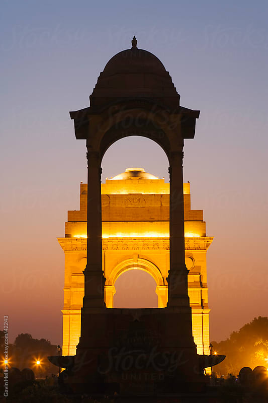 India, Delhi, New Delhi, India Gate illuminated at dusk by Gavin Hellier for Stocksy United