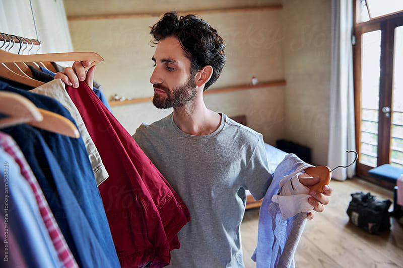 man choosing outfit by Daxiao Productions for Stocksy United