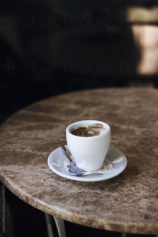 Drained coffee on table by Jovana Rikalo for Stocksy United