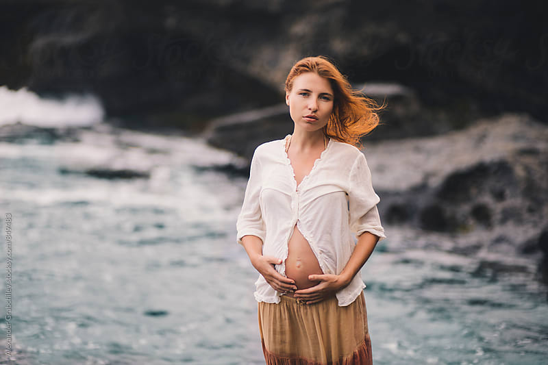 Pregnant Woman at the Beach by Alexander Grabchilev for Stocksy United