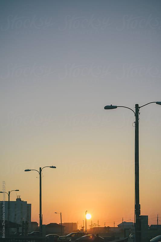 Street lamps on sunset by Borislav Zhuykov for Stocksy United