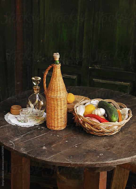 wooden table with traditional drink and food by Sonja Lekovic for Stocksy United
