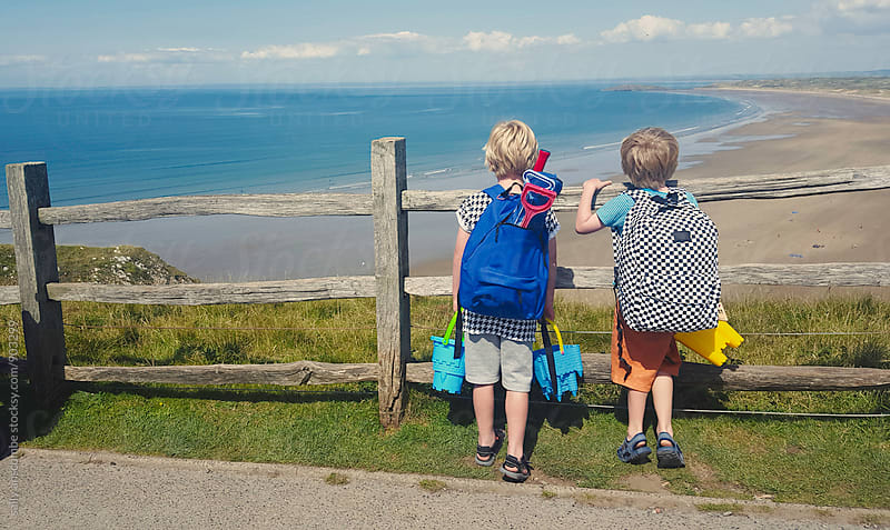 Two children on their way to the beach by sally anscombe for Stocksy United