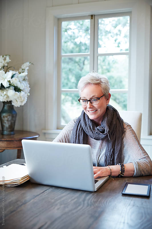 Stylish mature woman working from home by Trinette Reed for Stocksy United