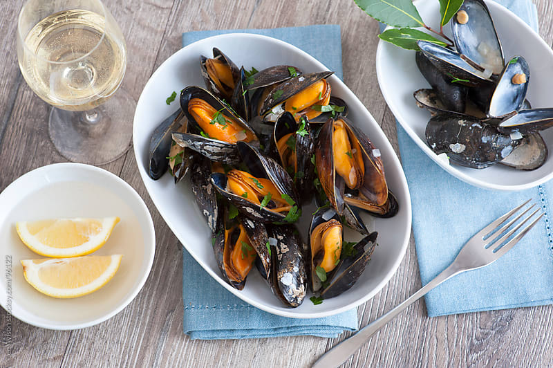 moules marinieres cooked mussels by Lee Avison for Stocksy United