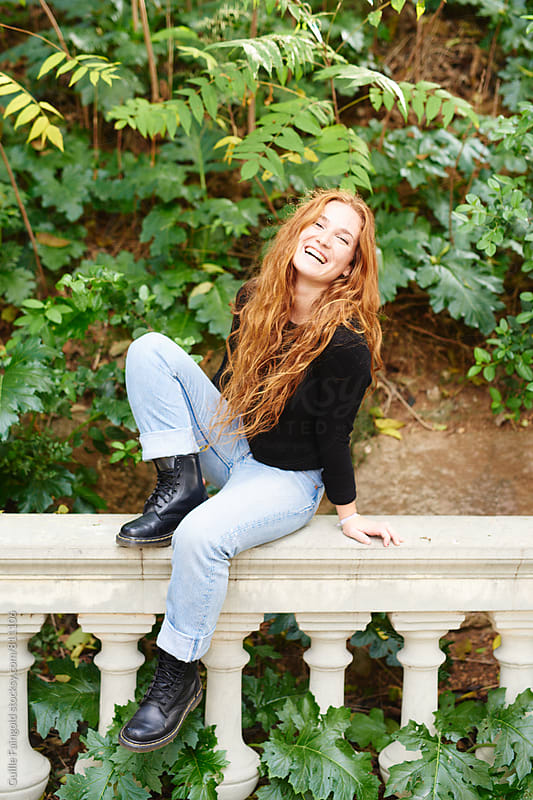 redhead woman at the urban park by Guille Faingold for Stocksy United