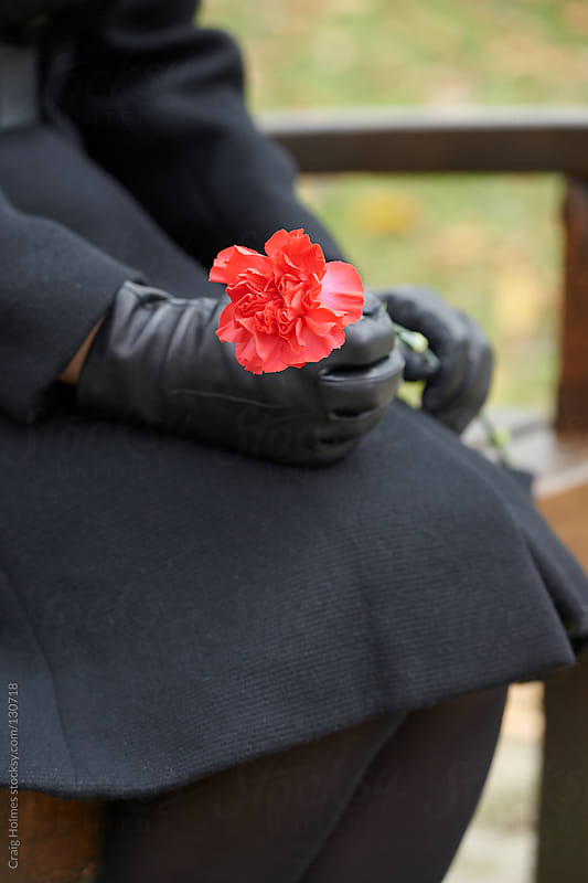 Woman in mourning at a funeral by Craig Holmes for Stocksy United