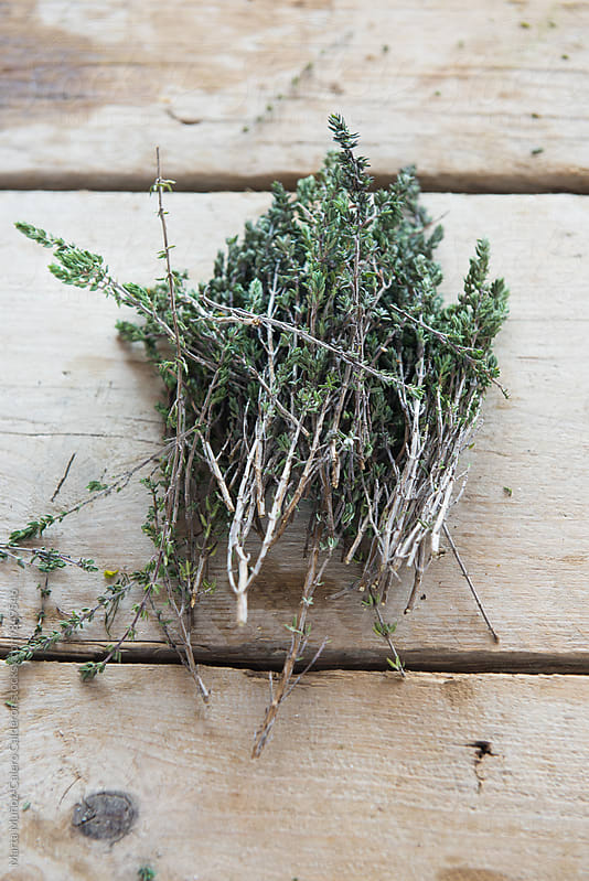 Thyme on a vintage wood surface by Marta Muñoz-Calero Calderon for Stocksy United