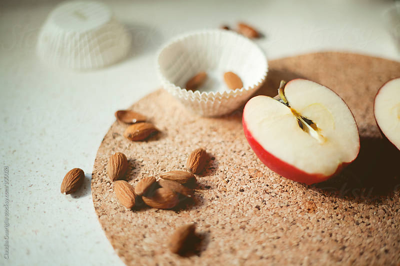 Apples and almonds by Claudia Guariglia for Stocksy United