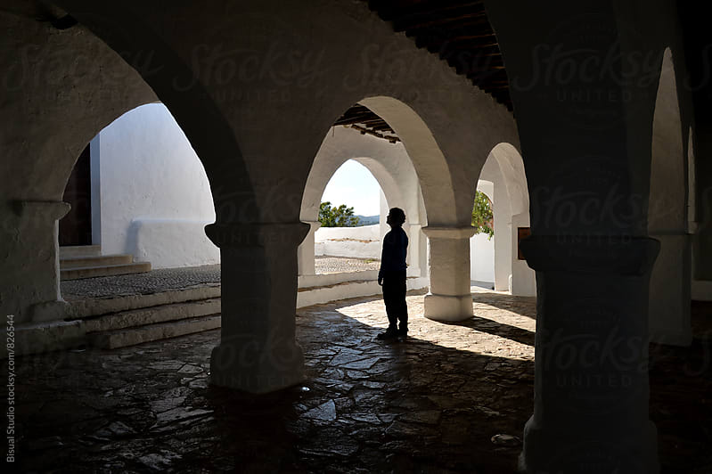 Silhouette of a man between the arches  by Bisual Studio for Stocksy United