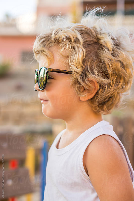 Little blond boy with sunglasses by ACALU Studio for Stocksy United