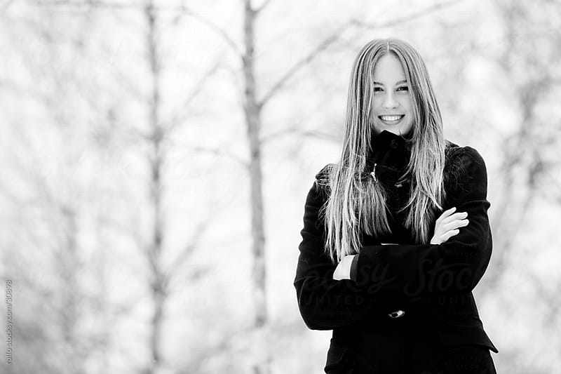 female portrait outdoors positive expression by rolfo for Stocksy United