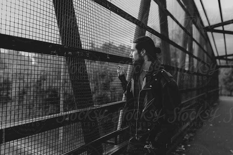 Handsome Man Walking on the Bridge by HEX . for Stocksy United