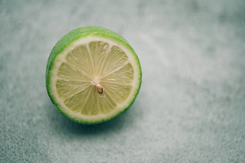Lime on a table by Adrian Cotiga for Stocksy United