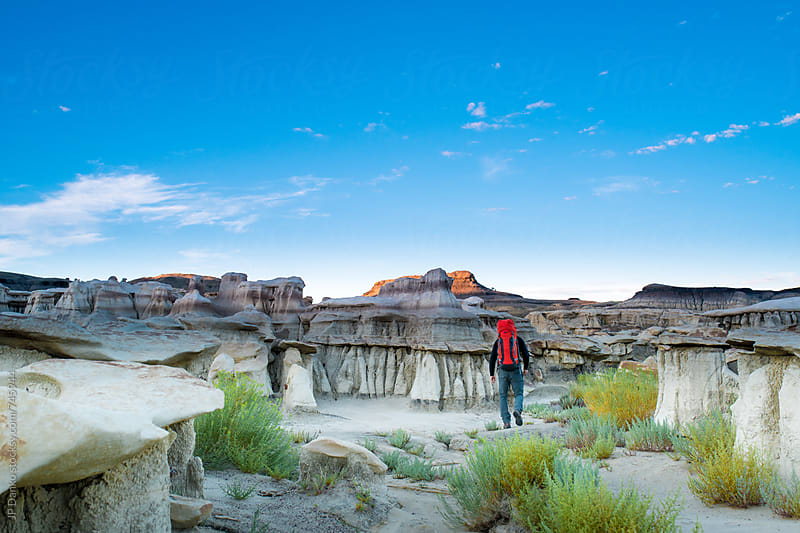 Backpacker Hiking in Bisti Badlands Wilderness Area New Mexico at First Light by JP Danko for Stocksy United