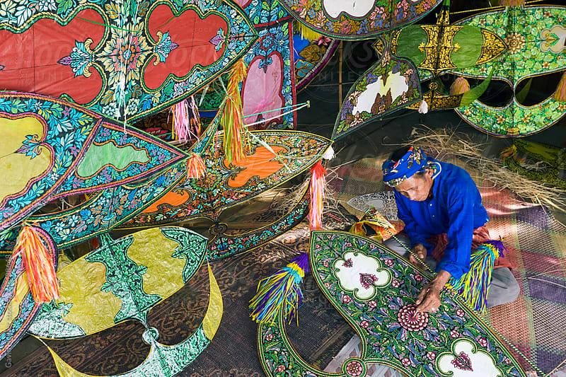 Asia, Malaysia, Kelantan State, Kota Bharu, Master Kite-maker constructing his world famous Kites by Gavin Hellier for Stocksy United