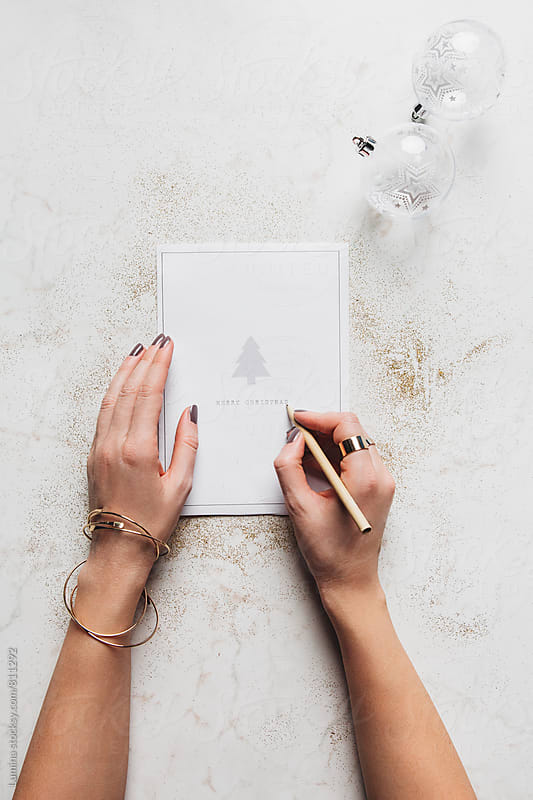 Woman Writing on a Christmas Card by Lumina for Stocksy United