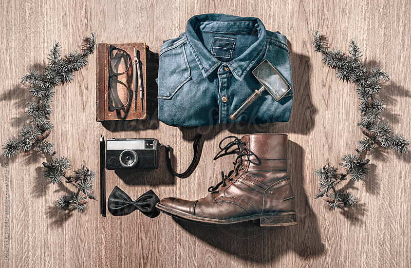 The objects of a hipster man in order on a wood background. by BONNINSTUDIO for Stocksy United