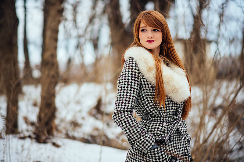 Young Ginger Woman Standing in a Winter Park by Mosuno for Stocksy United