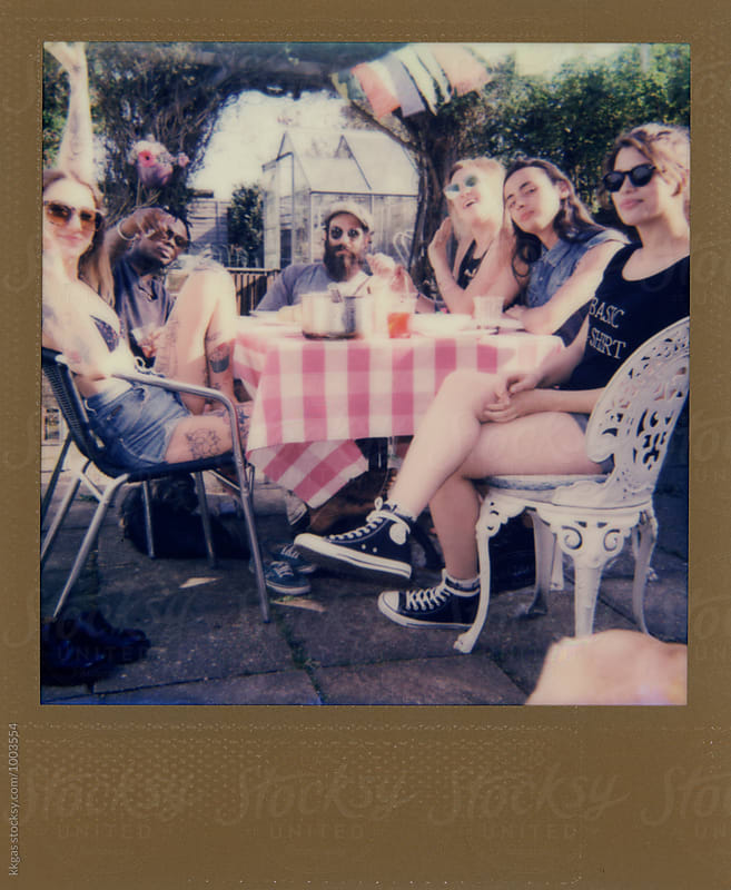 Gold Polaroids of a group of young people having a party by kkgas for Stocksy United