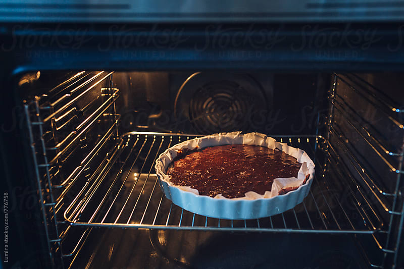 Chocolate Cake Baking in the Oven by Lumina for Stocksy United