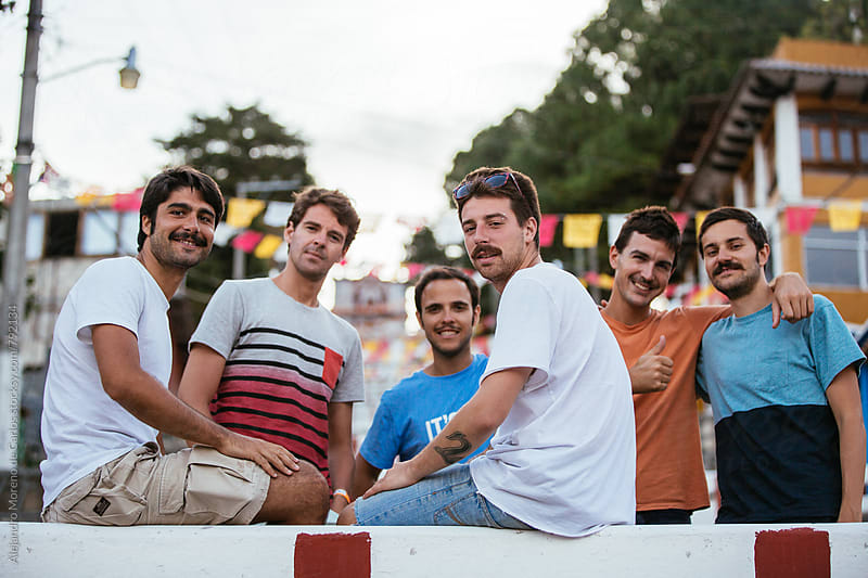 Group of young men hipster friends during a festivity in a local village of Chiapas, Mexico by Alejandro Moreno de Carlos for Stocksy United