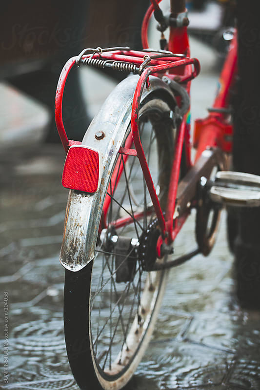 Red vintage bicycle on Barcelona street. by BONNINSTUDIO for Stocksy United
