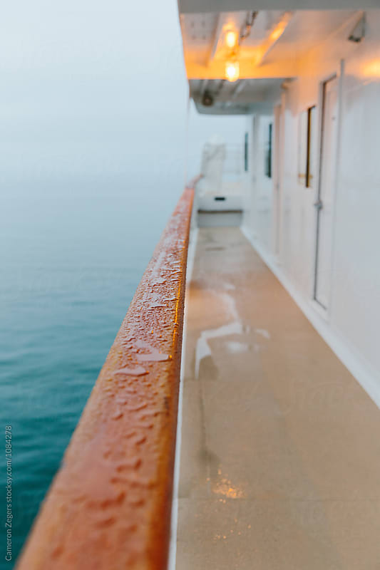 wet ship railing by Cameron Zegers for Stocksy United