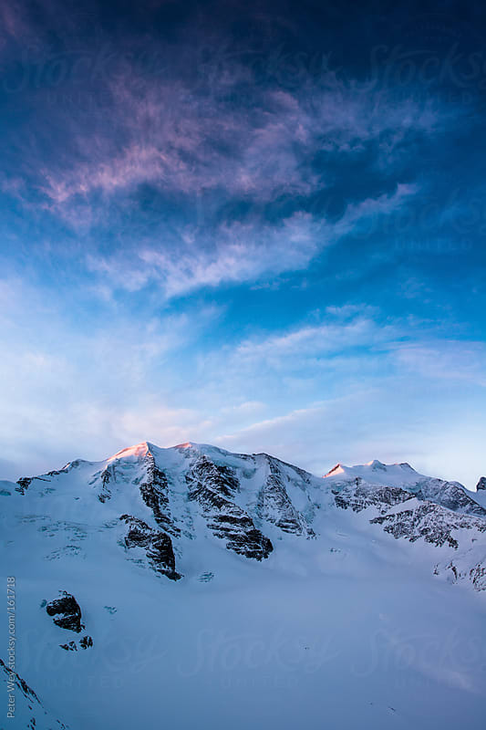 Piz Palu at sunrise by Peter Wey for Stocksy United