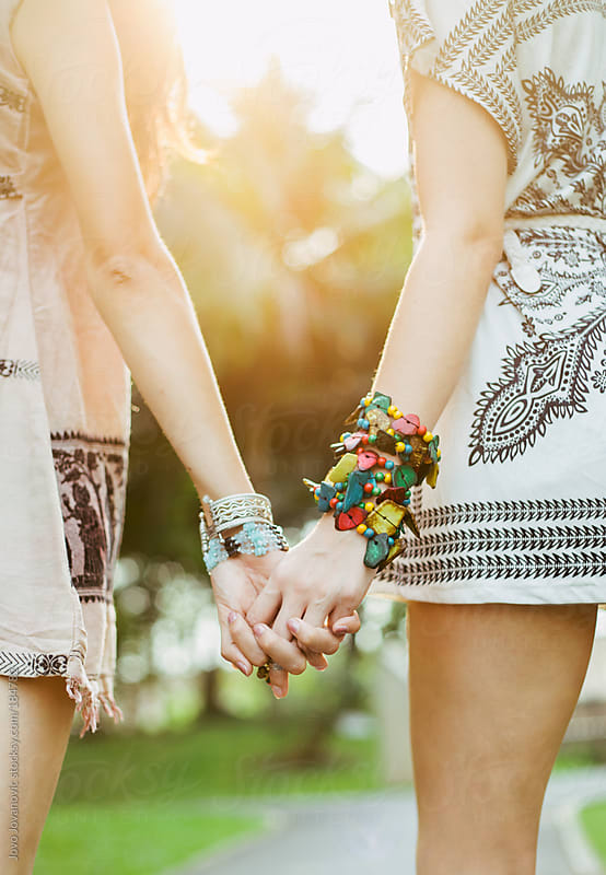 Friendship - two girls enjoying summer day and holding hands by Jovo Jovanovic for Stocksy United