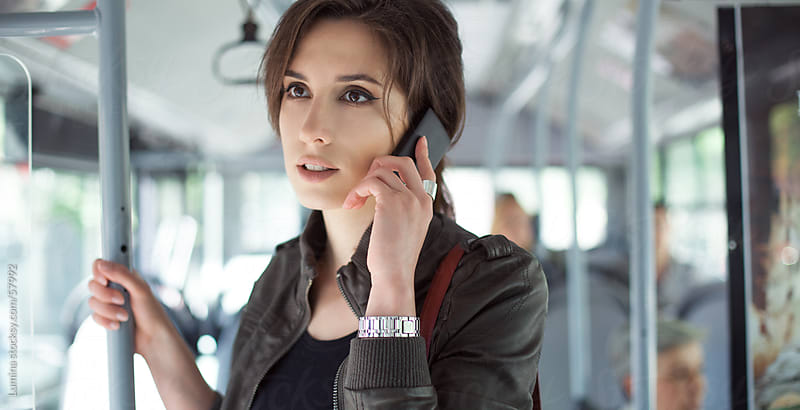 Woman Telephoning on the Bus by Lumina for Stocksy United
