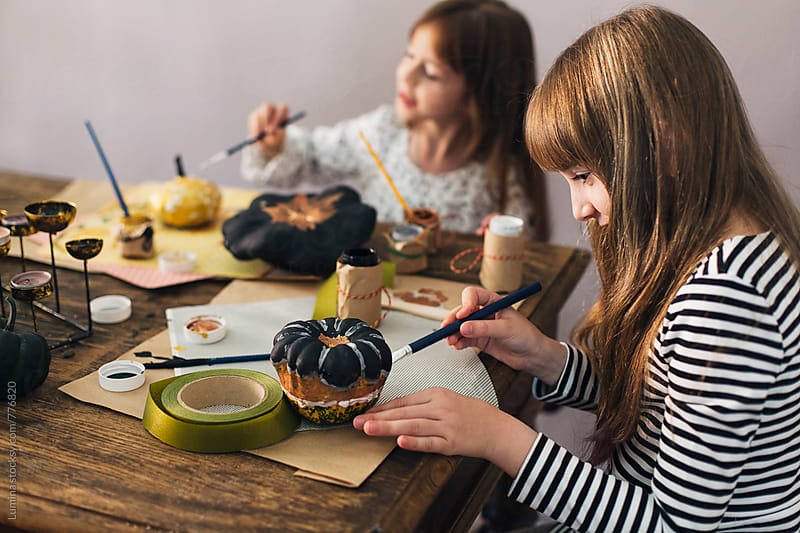 Girls Decorating Pumpkins for Halloween by Lumina for Stocksy United