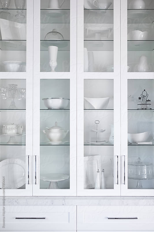 Large White Kitchen Dresser with serving dishes and platters by Rowena Naylor for Stocksy United