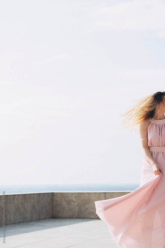 Woman in a long pastel dress on wind by Jovana Rikalo for Stocksy United