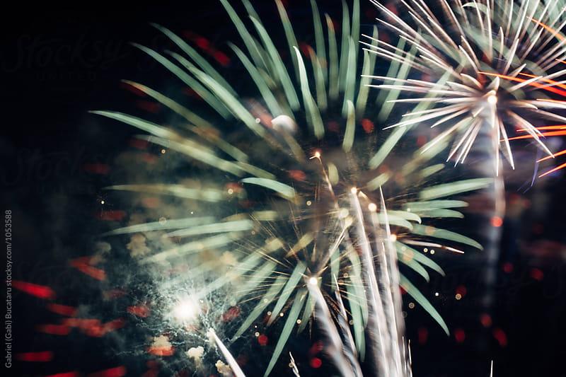 Fireworks against a dark sky by Gabriel (Gabi) Bucataru for Stocksy United