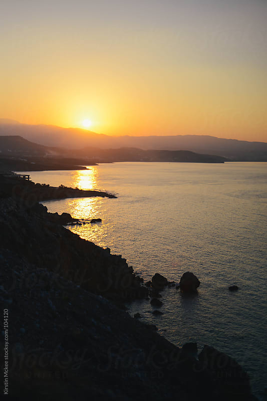 Sunset over the coast of Crete by Kirstin Mckee for Stocksy United