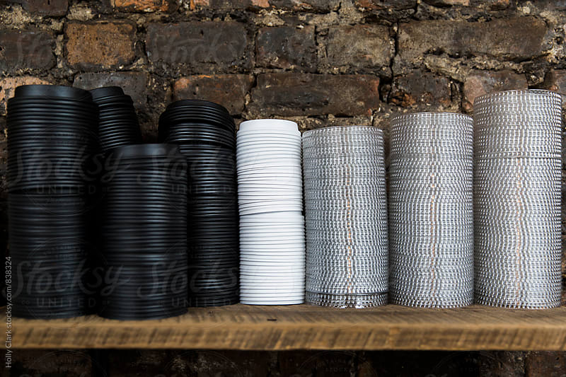 Stacks of Lids for Plastic Coffee Cups by Holly Clark for Stocksy United