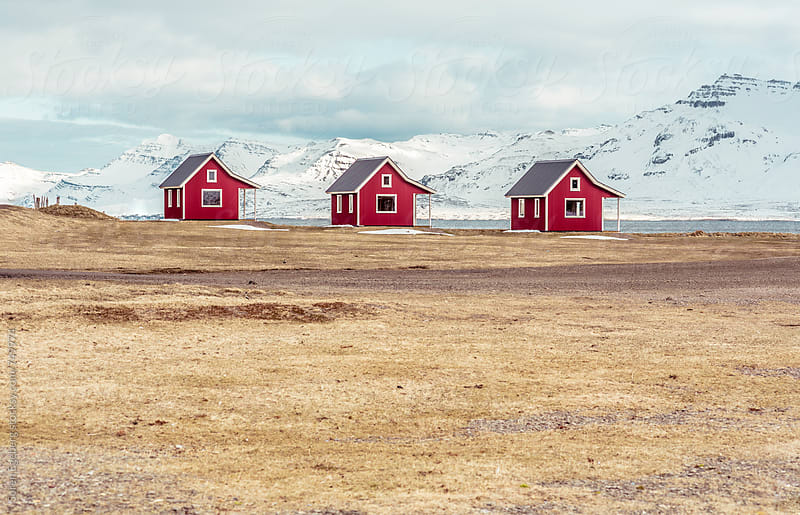 Traditional Icelandic houses by the mountains in winter by Søren Egeberg Photography for Stocksy United