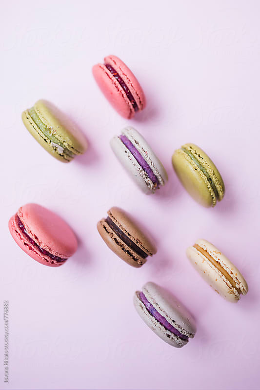 Colorful macaroons on a pink background by Jovana Rikalo for Stocksy United