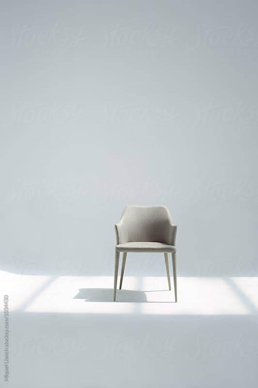 Beautiful grey chair in the studio by Miquel Llonch for Stocksy United